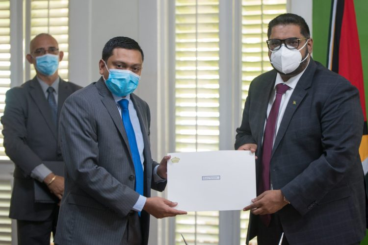 President of the Cooperative Republic of Guyana, His Excellency, Dr. Mohamad Irfaan Ali, presents Mr. Manoj Narayan with his Letter of Appointment