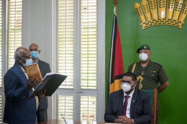 Former Minister of Local Government, Mr. Ganga Persaud taking his Oath of office