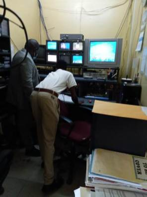 Transmission Operator, Deon Jackman shows Minister within the Office of the Prime Minister, with responsibility for Public Affairs, Hon. Kwame McCoy the operation room