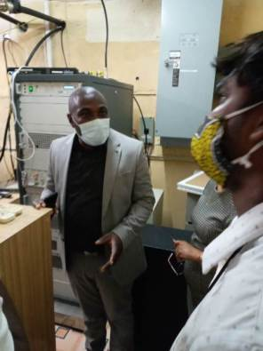 Minister within the Office of the Prime Minister, with responsibility for Public Affairs, Hon. Kwame McCoy, inspects the transmission room at NCN Berbice