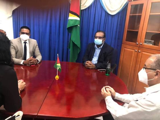 Minister of Local Government and Regional Development, Hon. Nigel Dharamlall, and Minister within the Ministry, Hon. Anand Persaud, in discussion with Cuban Ambassador to Guyana, His Excellency, Narciso Reinaldo Amador Socorro.