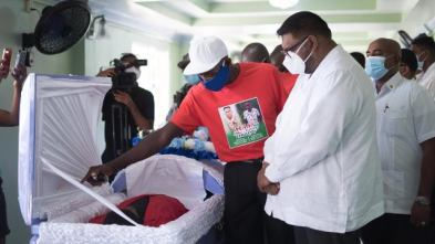 His Excellency Dr Irfaan Ali this morning joined the Henry family to pay final respects to Joel and Isaiah Henry. In this photograph, President Ali is consoling Mr. Gladston Henry, father of Isaiah Henry.