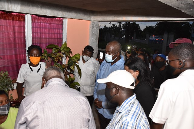 Prime Minister, Brigadier Mark Phillips; Minister of Human Services and Social Security, Dr. Vindhya Persaud and Minister of Home Affairs, Mr. Robeson Benn, interact with Mrs. Patricia Henry, mother of Master Isaiah Henry, who was killed recently along with his cousin.