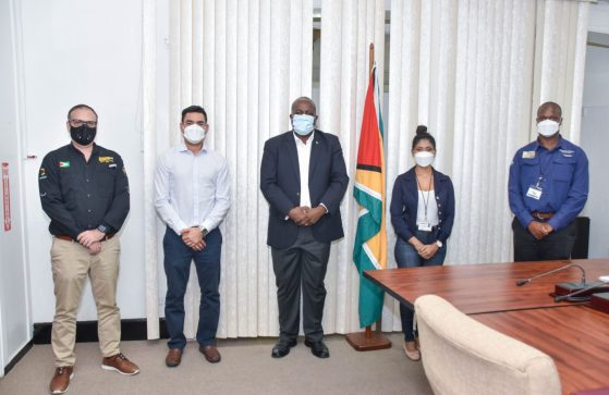 Prime Minister Brigadier Mark Phillips (centre) is flanked by, from left to right, senior executive members of the Machinery Corporation of Guyana Limited (MACORP) including Sales and Marketing Manager, Mr. Jordi Pinol; Chief Executive Officer, Mr. Guillermo Escarraga; Human Resources Manager, Ms. Anita Ramprasad and Service and Technical Operations Manager, Mr. Oswin Lynch.