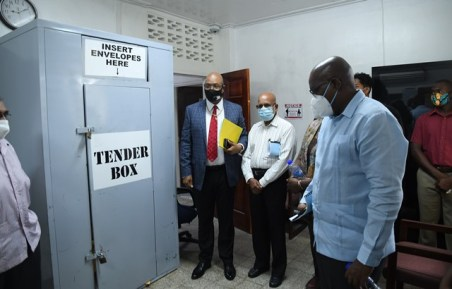 The new Board Members during a tour of the NPTAB office with Minister of Public Works, Hon. Bishop Juan Edghill