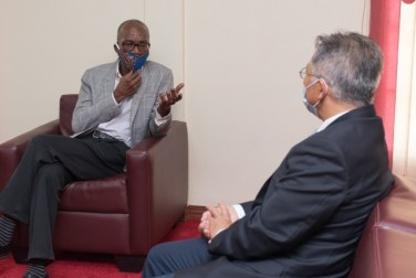 (left to right) Minister of Labour, Hon. Joseph Hamilton and Chinese Ambassador to Guyana, Cui Jianchun in discussion.