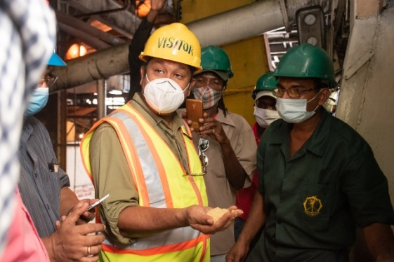 Guyana Sugar Corporation (GuySuCo)Chief Executive Officer, Sasenarine Singh (middle) with staff of one of the operating estates