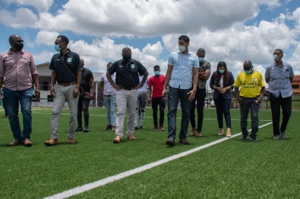 Minister of Culture, Youth and Sport, Hon. Charles Ramson Jnr. (fourth from left) and other officials tour a football field
