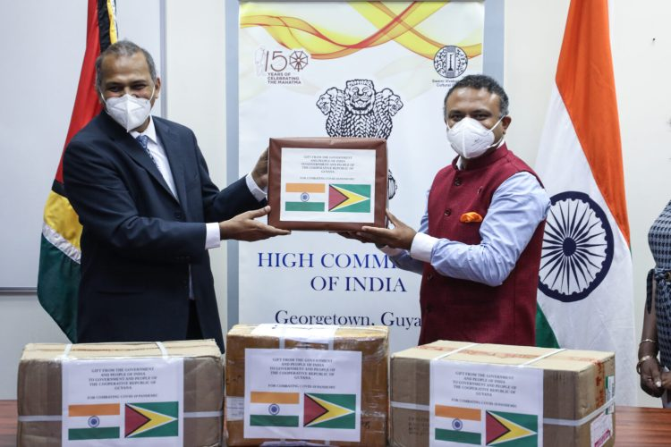 High Commissioner of India, His Excellency, Dr. K.J. Srinivasa handing over the medical supplies to Minister of Health, Hon. Dr. Frank Anthony
