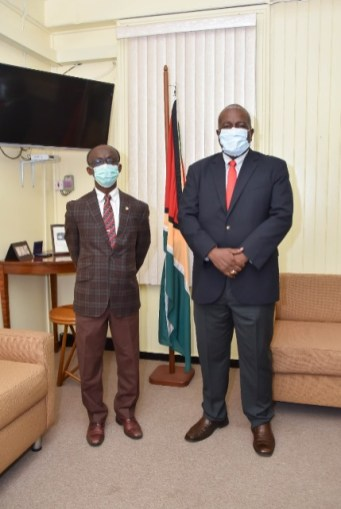 Prime Minister Brigadier Mark Phillips and PAHO/WHO Country Representative, Dr. William Adu- Krow following their meeting at the Office of the Prime Minister.