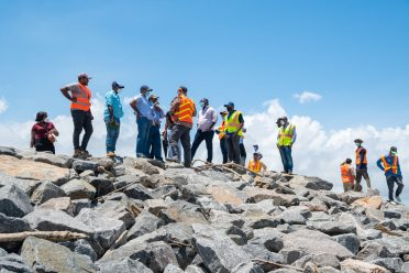 Minister of Public Works, Hon. Bishop Juan Edghill and a team from the Ministry examine emergency works ongoing along the Dantzig and Fairfield foreshores