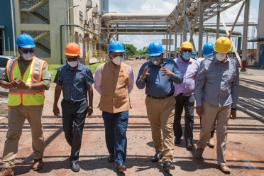 A tour of the facilities: Minister of Agriculture Hon. Zulfikar Mustapha leads Indian High Commissioner to Guyana, His Excellency Dr. K. J. Srinivasa, and other officials on a tour of the Skeldon Sugar Estate.