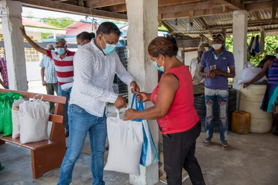 Minister within the Ministry of Public Works, Hon. Deodat Indar distributes relief hampers in Region Three