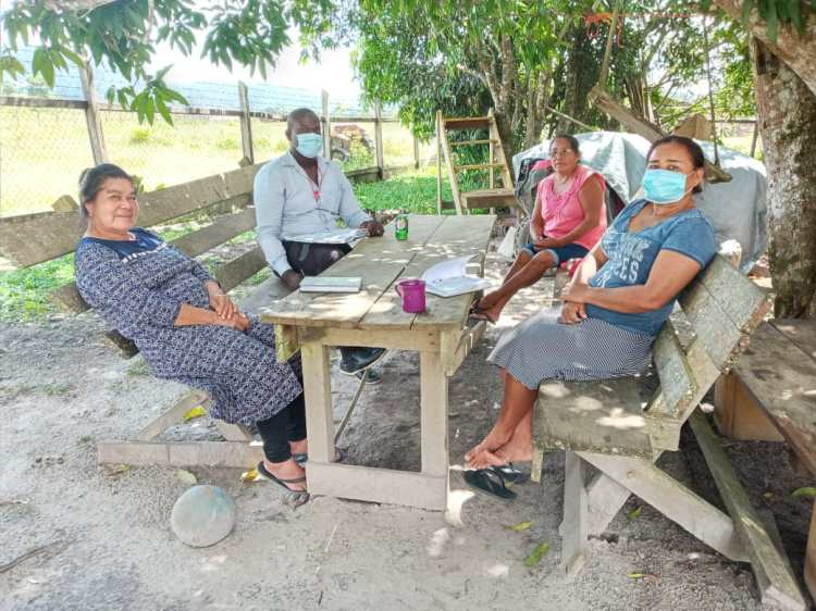 Senior Probation Officer, Mr. Milton Smith in a meeting with community counsellors at Paramakatoi, Potaro-Siparuni (Region Eight)