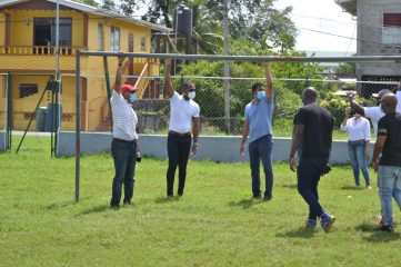 Minister of Culture Youth and Sport, Hon. Charles Ramson Jr. examines work done at Agricola's Evan Phillips Park