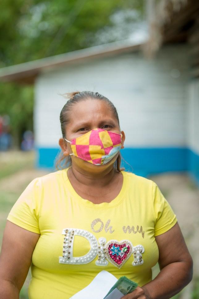 Orealla resident, Ms. Reita Romulo was pleased to collect COVID-19 $25,000 cash grant
