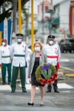 US Ambassador to Guyana, Sarah-Ann Lynch lays a wreath