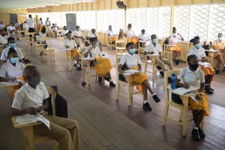 Students in a socially distanced class room at the Brickdam Secondary School