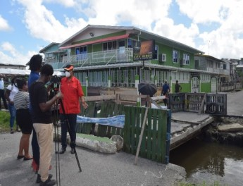 Minister Edghill speaks with the media concerning the Sussex Street Bridge