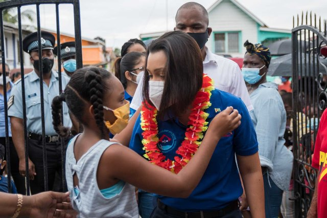 This little girl greets Minister of Housing and Water, Hon. Susan Rodrigues on her arrival at Middle Road, La Penitence.