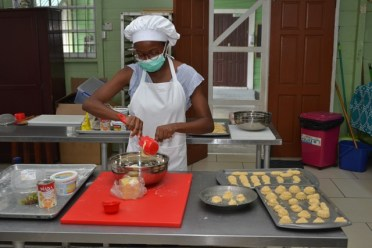 A resident of Linden participates in the bakery incubator trainer of trainers programme at Carnegie School of Home Economics.