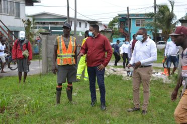 Minister of Local Government and Regional Development Hon. Nigel Dharamlall and this resident discuss the ongoing works