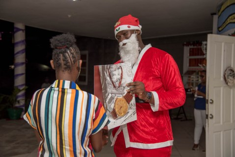 A member of the Youth in Natural Resources performs Santa duties