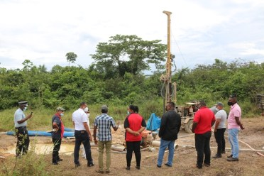 Minister Croal along with GWI and regional officials at the well drilling site in Port Kaituma
