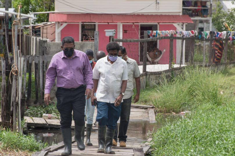 Minister of Agriculture, Hon. Zulfikar Mustapha and NDIA Chief Executive Officer, Mr. Fredrick Flatts conduct flood assessments along the East Coast Demerara corridor on November 3, 2020