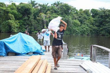 Residents along the Berbice river uplifting their food hampers