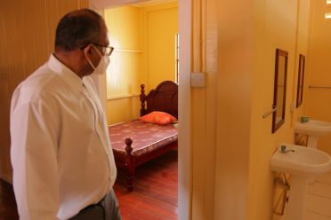 Minister of Health Hon. Dr Frank Anthony inspects one of the rooms at the $12M COVID-19 facility in Pomeroon-Supenaam Region