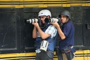 Teamwork In Action: Two Palestinians journalists covering the clashes. Photo By Ma'moun Wazoaz