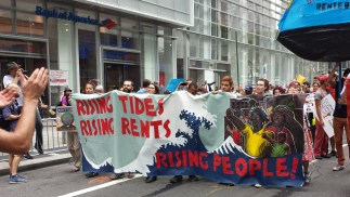 a group of marchers carrying a banner
