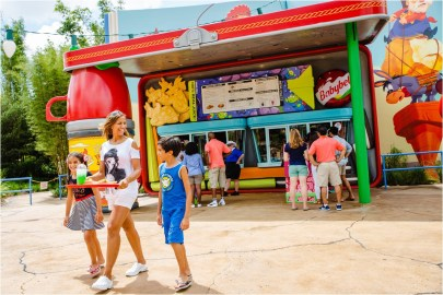 Woody's Lunch Box is a quick-service food and beverage location serving tasty meals and old-fashioned soda floats in Toy Story Land at Disney's Hollywood Studios. The walk-up window – open for breakfast, lunch and dinner – dishes up all sorts of sandwiches and sides that put a spin on classic recipes. Walt Disney World Resort collaborated with Mini Babybel to bring Woody's Lunch Box to life. Inside the 11-acre Toy Story Land, guests can whoosh along on the family-friendly roller coaster, Slinky Dog Dash, take a spin aboard Alien Swirling Saucers and try for the high score on Toy Story Mania! (Steven Diaz, photographer)