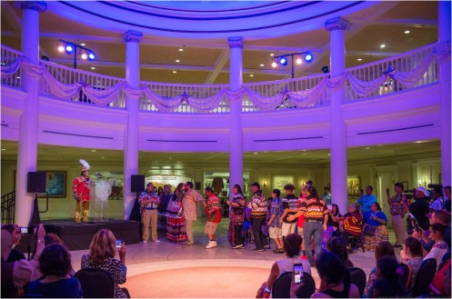 """Members of the Seminole Tribe participate in a music and stomp dance, Friday, July 27, 2018, to celebrate the opening of the Walt Disney World Resort gallery exhibition """"Creating Tradition: Innovation and Change in American Indian Art"""" in The American Adventure pavilion at Epcot. The gallery exhibit showcases the work of contemporary Native artists alongside artifacts from centuries past. The pieces demonstrate how ancestral American Indian craftsmanship influences modern generations of Native artists. The exhibition features items on loan from the Smithsonian's National Museum of the American Indian, the Museum of Indian Arts and Culture, the Seminole tribe, the Potawatomi tribe and Richard Hammel. (Kent Phillips, photographer)"""