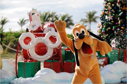 "The holidays take on a tropical flair at Disney's private island in the Bahamas, Castaway Cay, with ""snow flurries,"" a decked-out Christmas tree, Disney character meet-and-greets and holiday island music. (Kent Phillips, photographer)"