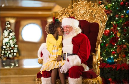 "Holidays are magical aboard the Disney Dream with visits from Santa. In the spirit of holiday cheer, Disney Cruise Line adds sparkle to each ship during Very Merrytime Cruises, with special stem-to-stern holiday events, traditional ""turkey day"" fanfare, Christmas feasts, ""snow flurries"" and New Year's Eve galas. (Kent Phillips, photographer)"