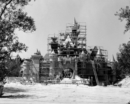 """SLEEPING BEAUTY CASTLE UNDER CONSTRUCTION (1955) Ð Two months before she """"awoke"""" to opening day visitors, this Disneyland landmark was getting a few final touches from construction workers. Walt Disney wanted this castle to be a friendly and welcoming presence in his park so it was built on a smaller scale than its European counterparts."""