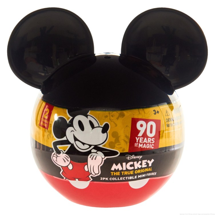 """Licensee: Just Play MSRP: $4.99 Description: Celebrate 90 years of Disney Magic with the Mickey's 90th Anniversary 2-Pack Mini Figures! These surprise Mickey Mouse shaped capsules each contain two 2.25"""" figures inside – open the capsule to reveal the two new additions to your Disney collection! Collect Mickey Mouse through the ages with these highly detailed posed figures including: Plane Crazy Mickey & Classic Mickey; Pie Eye Mickey & Sorcerer's Apprentice Mickey; Comic Mickey & Clubhouse Mickey; Steamboat Willie & Technicolor Mickey; New Shorts Mickey & Mouseketeer Mickey. Each capsule is sold separately, and figures come in a fun mini size – perfect for kids and collectors alike. Availability: 8/20 Retailer: Target, KMart, Walmart"""