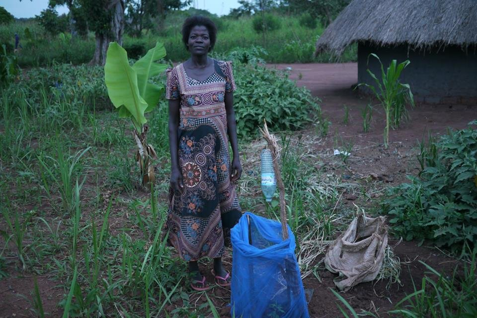 Oromo with a tree seedling she planted