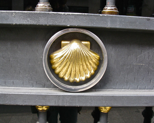 The scallop shell symbol as it appears on a door in Santiago de Compostela