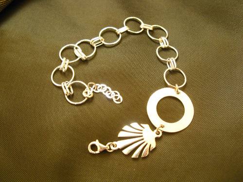 Gift this precious pilgrim charm bracelet with a symbolic scallop shell