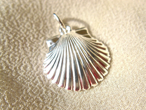 Reverse of sterling silver scallop shell
