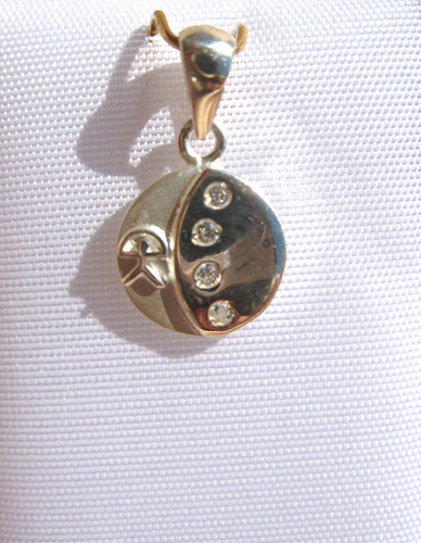 Close-up of Indalo button pendant