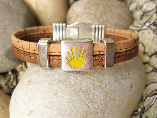 Two-tone cork bracelet showing the Way of St James waymarker symbol