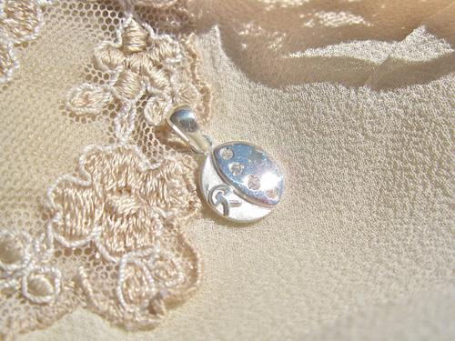 Button pendant ~ lucky Indalo,  silver AII022