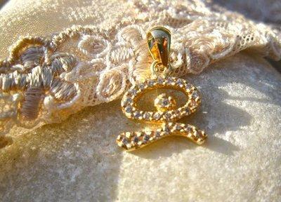 Indalo pendant ~ dancing, 18ct gold + zirconite