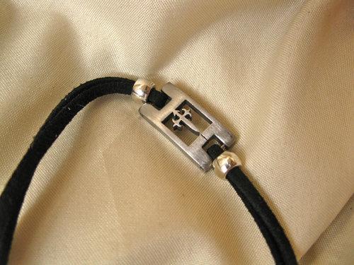 Black Compostela pilgrim bracelet with symbolic St James cross