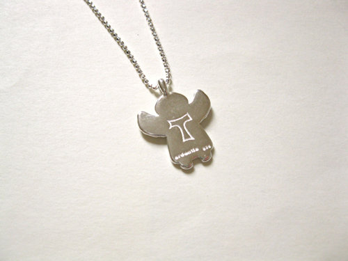 Tau cross engraved on the back, symbolic of a journey or pilgrimage