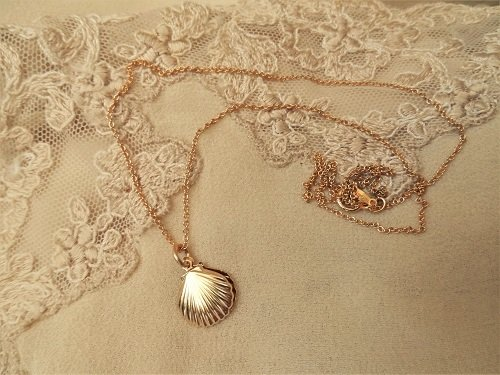 "The scallop shells hang on an 18"" gold-filled chain"